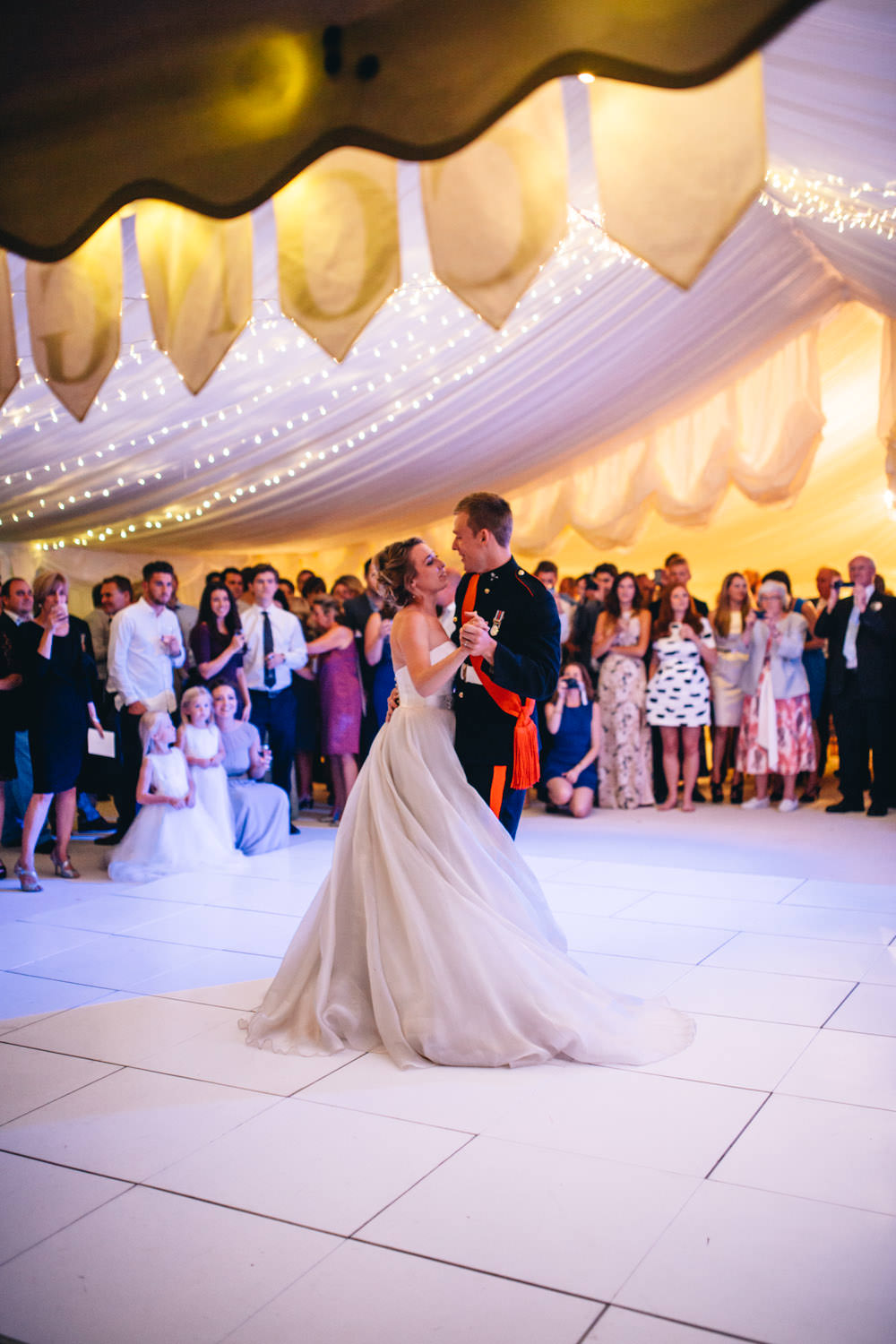 Bride in gracie suzanne neville wedding dress with grey bridesmaid image by a ombrellifo Images