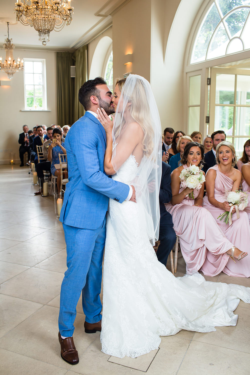 Romantic blush pink wedding at iscoyd park with pronovias bridal gown iscoyd park wedding ceremony with bride in pronovias wedding dress groom in blue hugo boss ombrellifo Images