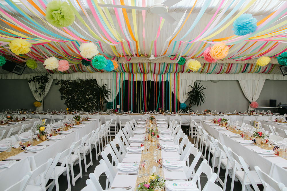 vibrant outdoor blessing marquee reception colourful streamer decor intimate town hall city ceremony pub lunch two wedding dresses mint green