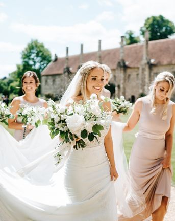 Mirror Table Plan, Garden Games and Floral Arch for Black Tie Marquee Wedding