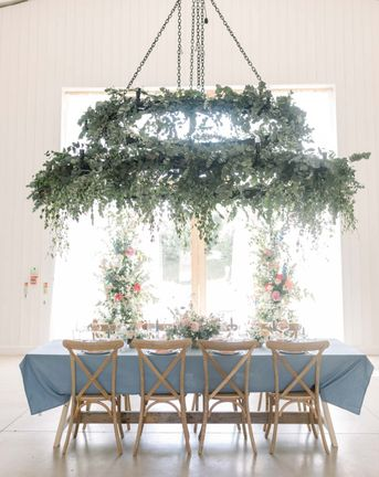 Pastel wedding inspiration at The White Barn in Somerset with vertical floral arrangements