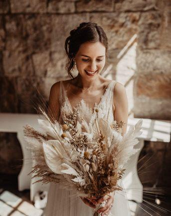 Bride with Dried Flower Wedding Bouquet