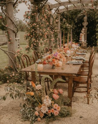 Summer wedding inspiration at Euridge Manor with orange, coral and peach wedding flowers and decor, and with Made With Love dresses