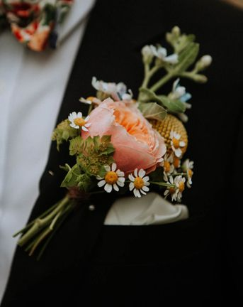 Roundup of stylish groom buttonholes with fresh and dried flowers, foliage, feathers and pins.