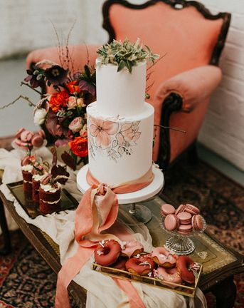 painted wedding cake and terracotta wedding inspiration in an industrial wedding venue