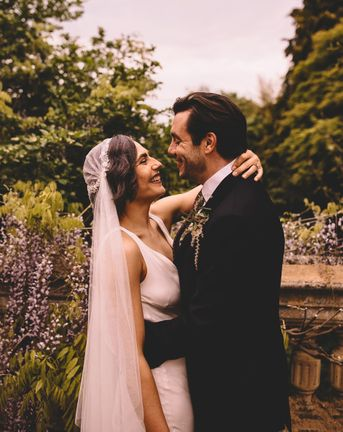 Satin bridal gown and Juliet wedding veil for an intimate town hall wedding  ceremony and pub reception