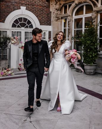 Stylish Mayfair wedding inspiration with Love In Lace Bridal gown with pockets and peeled back blush roses