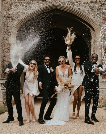 Modern luxury wedding with black tie fashion, dried and fresh flowers and a vintage car