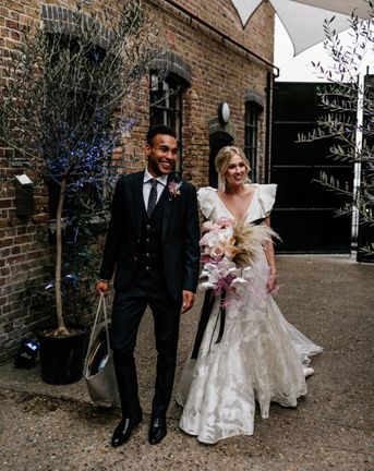 Contemporary London Wedding at The Loft Studios with Ruffle Wedding Dress by Epic Love Story