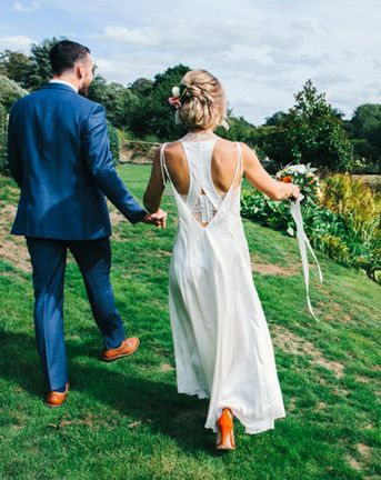 colourful pennard house wedding with bride wearing racerback dress