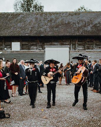 Mariachi Band and Persian Rug Aisle for Autumn Wedding | Needle & Thread Astral Dress | Pimhill Barn | Waitrose Naked Wedding Cake | Leah Lombardi Weddings