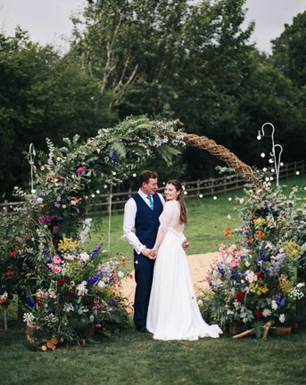 Moon Gate Arch With Bright Flowers For Garden Marquee Wedding