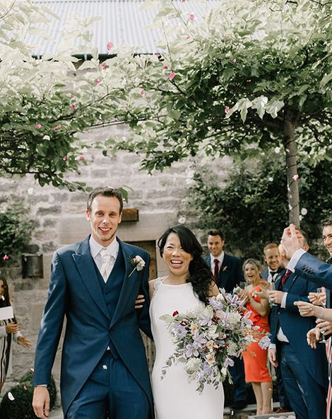 Healey Barn Countryside Wedding with Wild Flowers and Bride in Pronovias   Pronovias Wedding Dress   Georgina Harrison Photography
