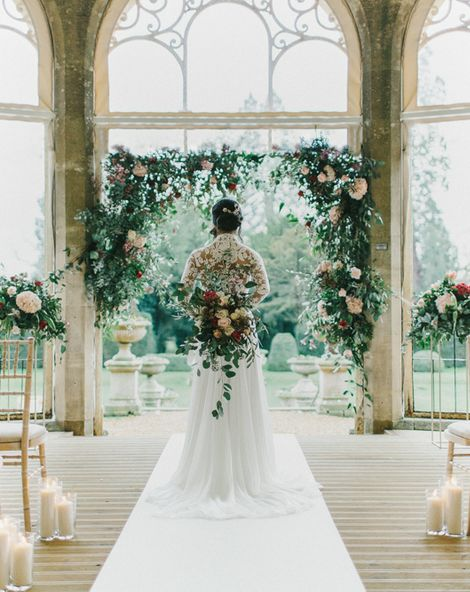Blush & Burgundy Floral Fairytale Wedding at Grittleton House Planned & Styled by Jennifer Louise Weddings with Floral Arch. Katherine Yiannaki Photography