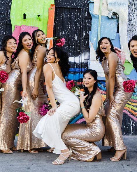Las Vegas Wedding with Gold Sequin Bridesmaids Dresses and Silk Flowers | BHLDN Wedding Dress | Neon Museum | Chris Barber Photography