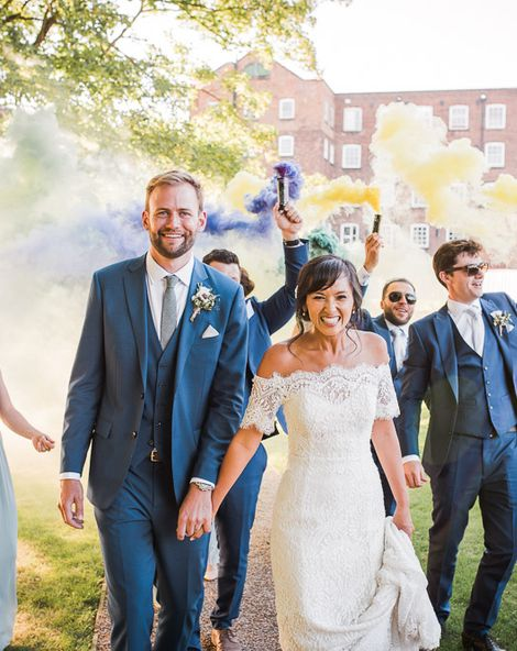Smoke Bombs and Chinese Paper Fans Backdrop with Bride in Bardot Dress   Watters Wedding Dress   ASOS Bridesmaids Dresses   Twig & Vine Photography
