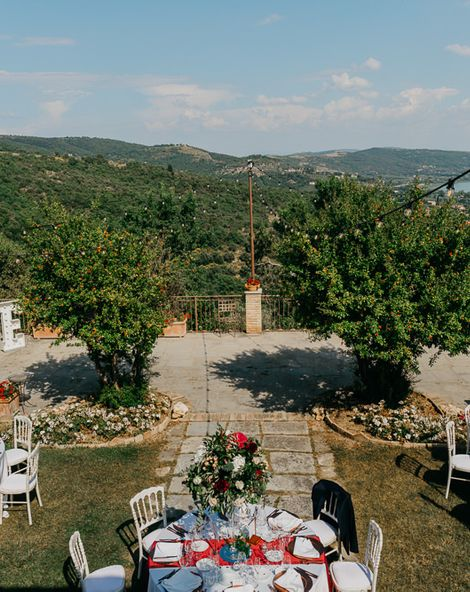 Wedding in Umbria, Italy with Red Flowers and DIY Copper Decor