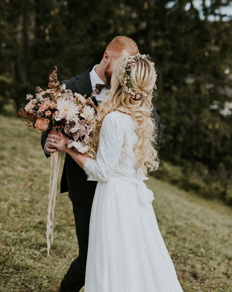 Dolomites Wedding on a mountain top with autumnal wedding bouquet and flower crown