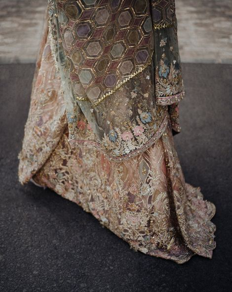 Pastel Bengali wedding dress and veil with gold thread geometric design for intimate Asian wedding
