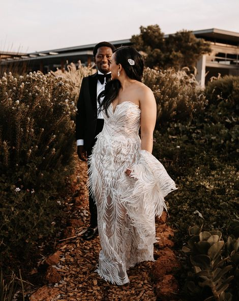Couture wedding dress with feathers for a luxury, black-tie wedding in South Africa with peach and gold decor and flowers