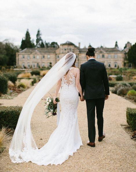 Luxurious Grantley Hall Wedding with elegant wedding cake, flowers and fashion