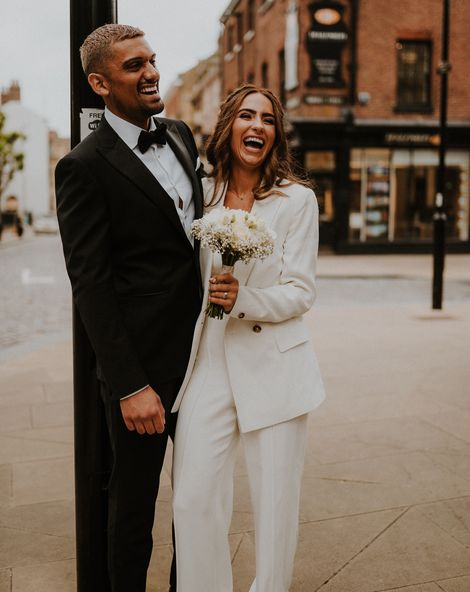 Intimate Sheffield registry office wedding with bridal suit, tuxedo and gypsophila flower crown