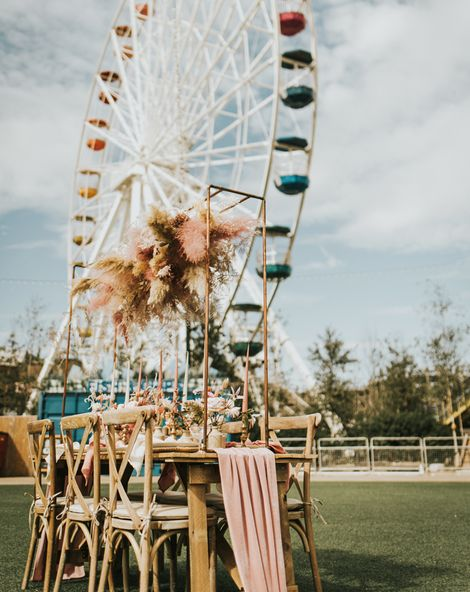 Pastel wedding inspiration at Dreamland Margate with astro slide, ferris wheel and outdoor reception with dried flowers