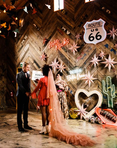 Fun Neon wedding inspiration at The Canary Shed in Essex with Red wedding dress, and colourful flowers