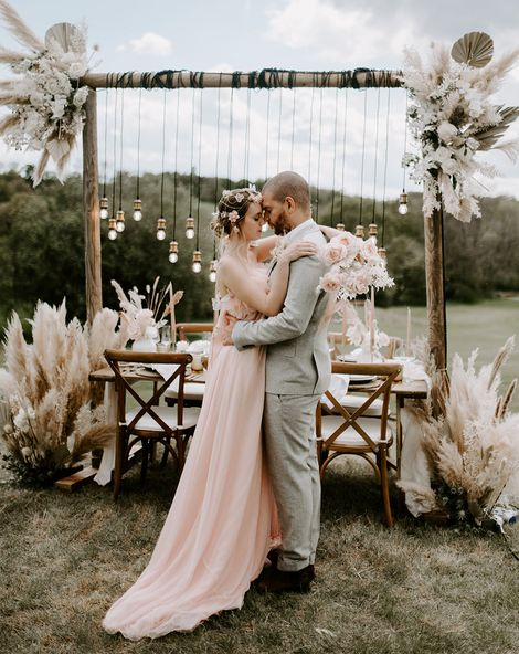 Boho luxe wedding inspiration at Waresley Park Estate with an outdoor reception, floral moon gate and blush wedding dress