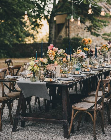 Wedding Table Decorations with candles, table runners, flowers and cutlery