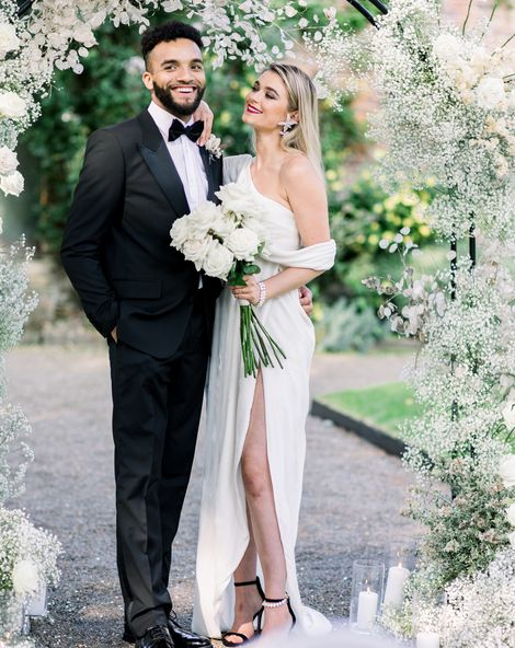 Sophisticated summer Garthmyl Hall wedding with white flowers and black-tie fashion