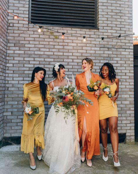 Mustard and orange wedding inspiration at an industrial wedding venue