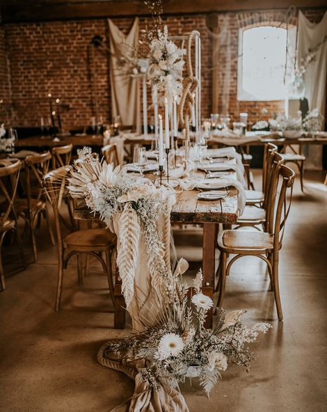 bohemian luxe wedding in a barn with white flowers and natural decor