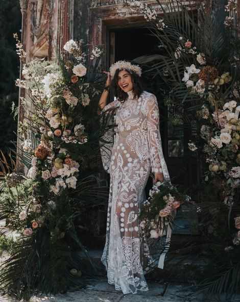 Boho destination Larmer Tree wedding inspiration with palms, muted florals and a lace wedding dress