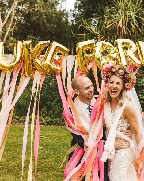 Pink and Peach Streamers, Gold Foil Balloons   Colourful Wedding Fiesta at Abbotsbury Wedding in Weymouth, Dorset   Decor from The Prop Factory   Bride in Made with Love   Photography by Paul Underhill.