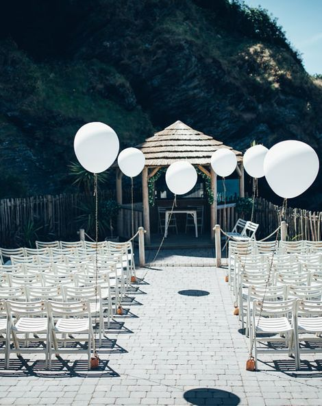 Gypsophila Arch and Giant Balloons for an Outdoor Coastal Wedding | Strapless Pronovias Ballgown Dress | ASOS Bridesmaids Dresses | Toby Lowe Photography