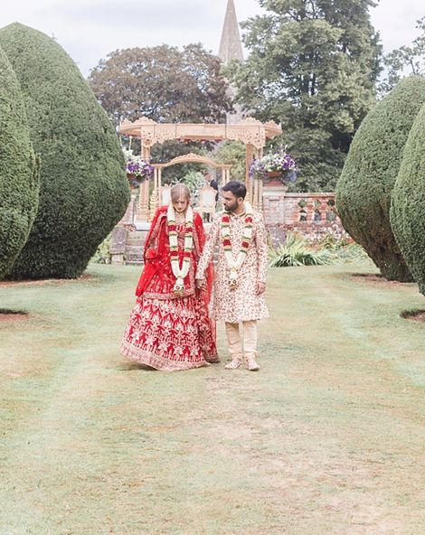 Hindu Wedding Ceremony At Fusion Celebration With Bright Flowers
