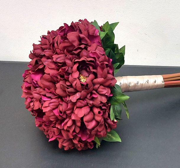 florals of splendour red peonies hand bouquet