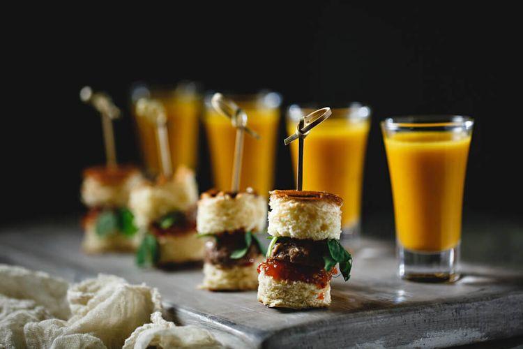 Mini burgers on brioche buns with tomato chilli relish. Shot glass of butternut squash sgae honey soup with parsley puree 3
