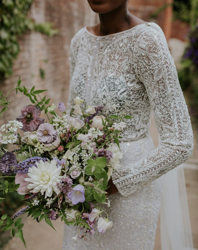 A Roundup of Stylish Long Sleeve Wedding Dresses including lace, applique, fitted, flare and sheer.