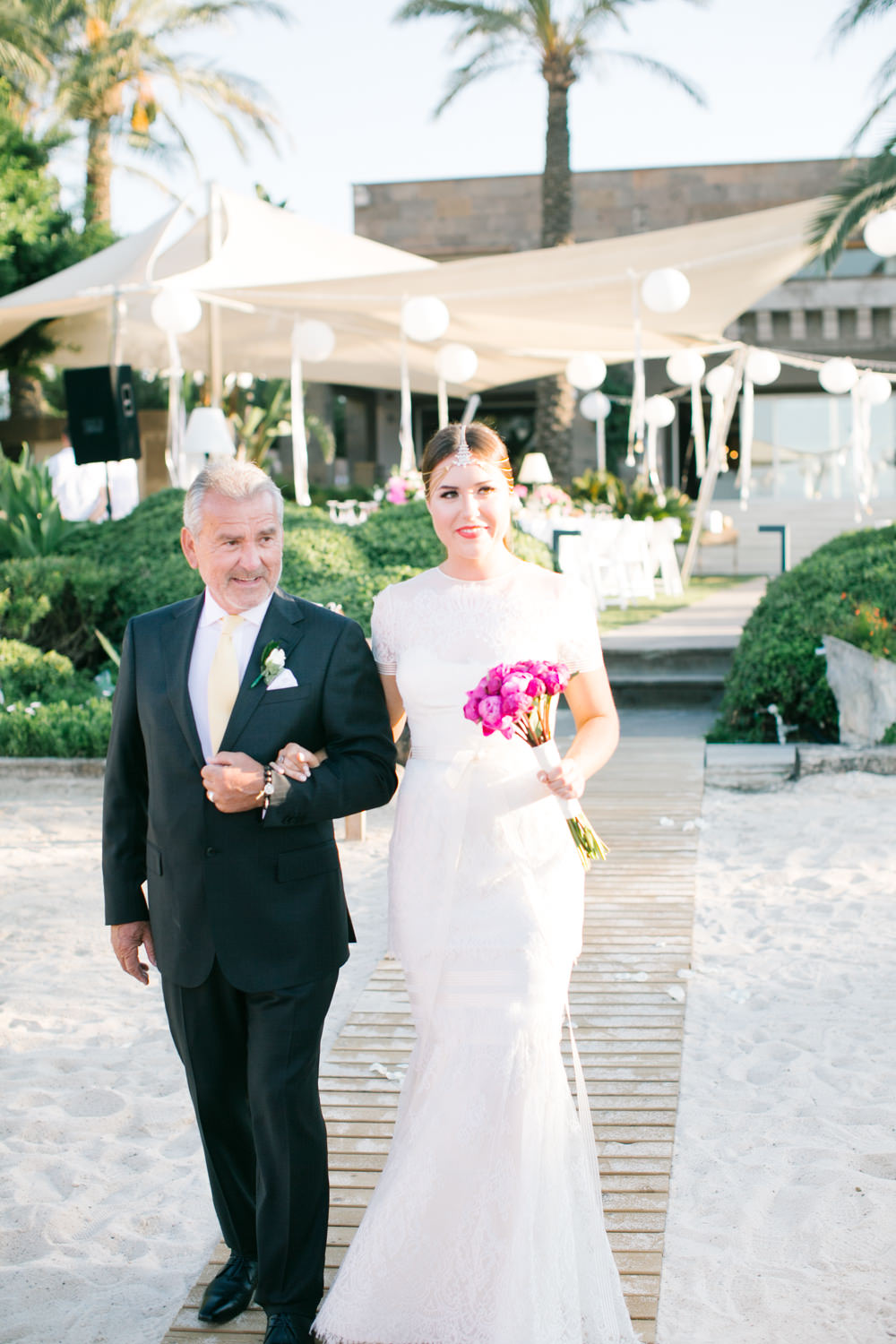 Elegant white gold turkey destination wedding with fuchsia pink image by a ombrellifo Images
