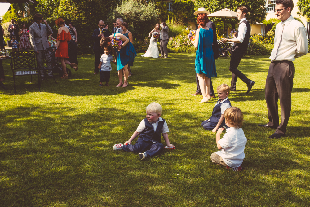 Colourful Wedding At South Farm Cambridgeshire with Bride In Gowns From Kitty And Dulcie And Monsoon