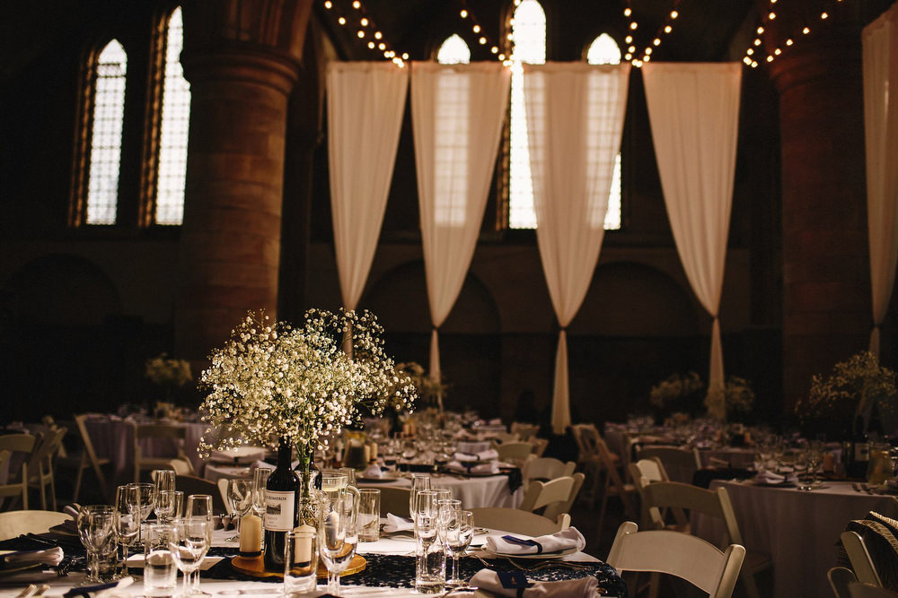 Traditional wedding at left bank derelict church wedding venue in leeds draped left bank derelict church wedding venue in leeds gypsophila in bottles table centrepieces junglespirit Gallery