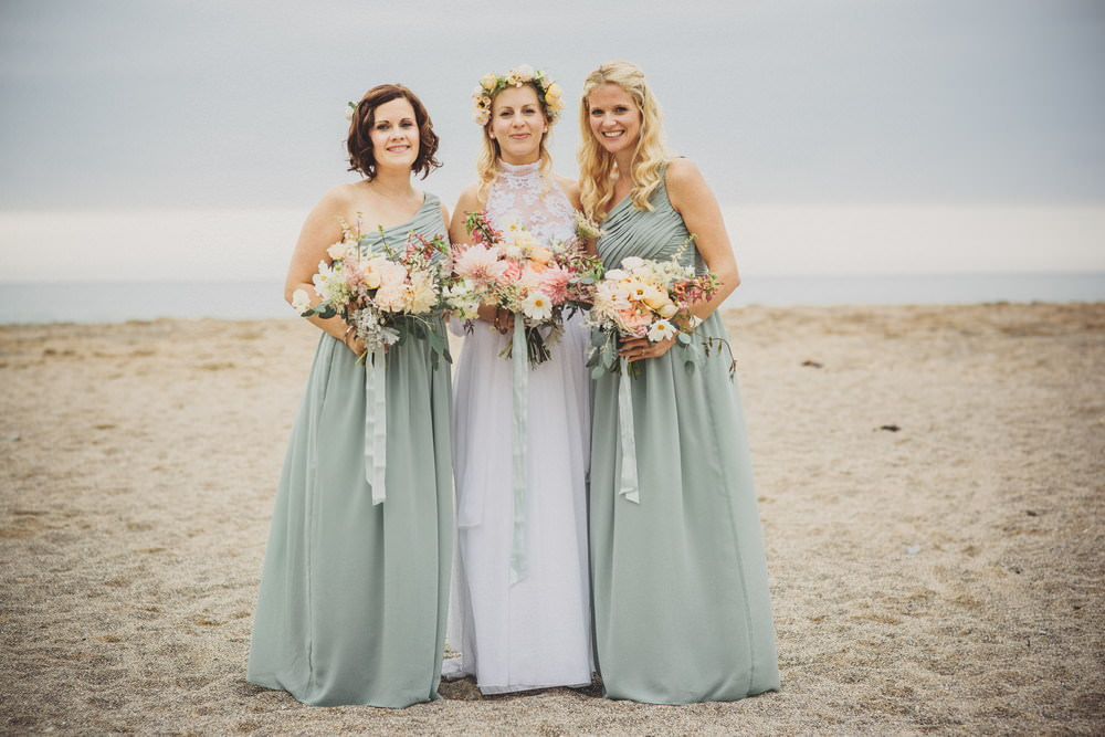 319507c8dbb Bohemian wedding dress from Grace loves Lace at a laid back coastal beach  wedding in Cornwall. Bridesmaids wear duck egg blue dresses from H M and  groomsmen ...