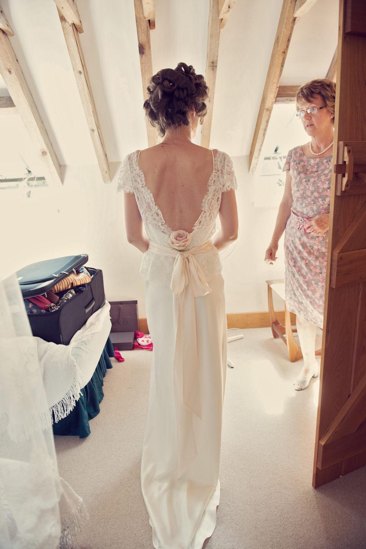 A Halfpenny London bohemian bridal gown for a wedding at Bignor Park ...