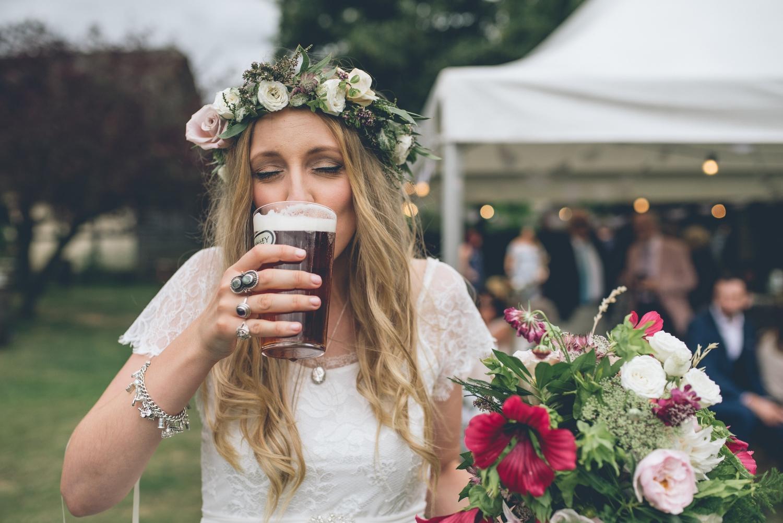 The fleece inn bretforton wedding bride in grace loves lace dress bride drinking real ale izmirmasajfo