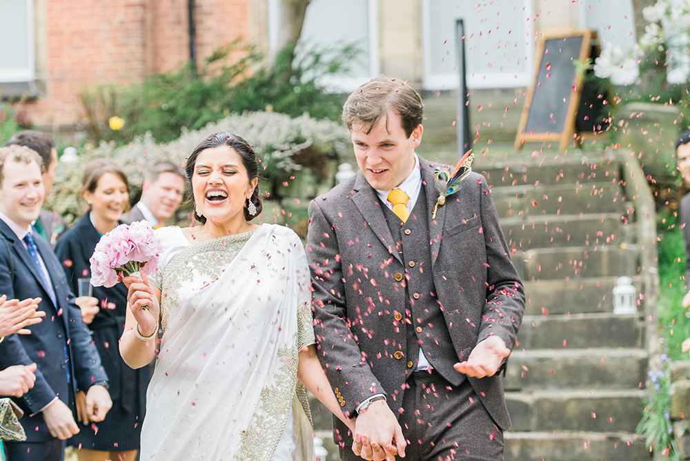 b198383d4c5 A Indian and British fusion wedding with a British Raj theme with  bridesmaids in traditional green saris and a pink peony bouquet by Folega  Photography.