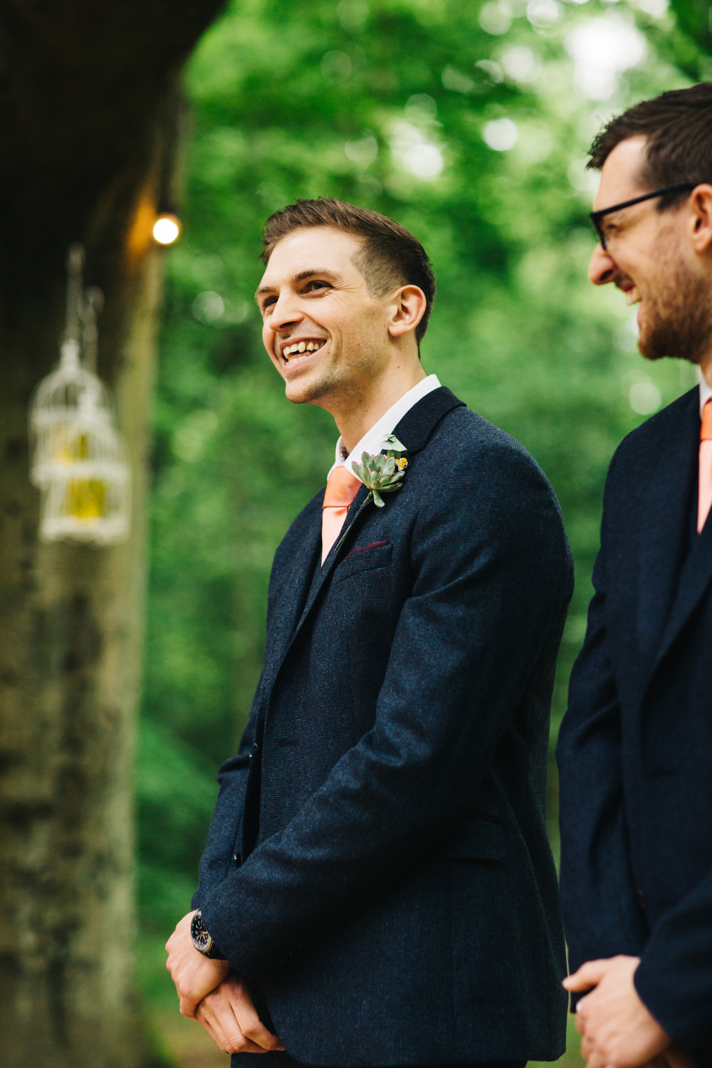 Diy rustic outdoor tipi wedding at ecclesall woods in sheffield bridesmaid dresses groom at the outdoor altar ombrellifo Choice Image