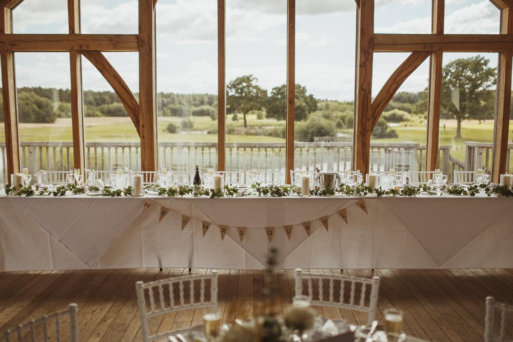 Rustic barn wedding at sandburn hall in yorkshire with stewart top table decor at sandburn hall yorkshire wedding reception junglespirit Images