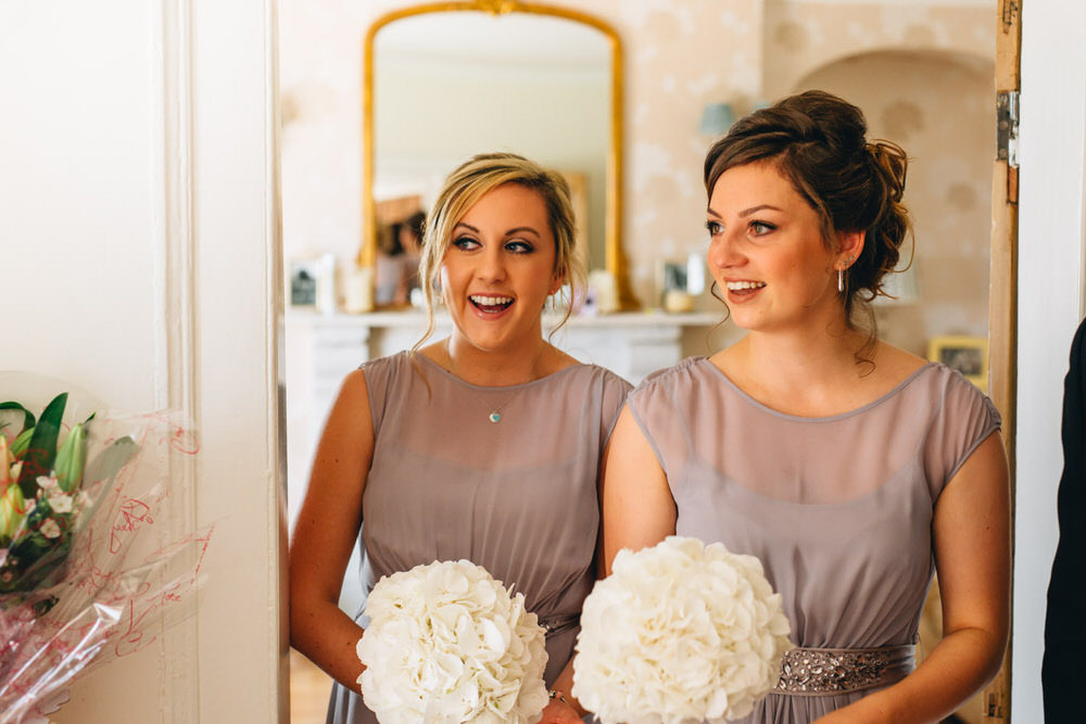 Bride in gracie suzanne neville wedding dress with grey bridesmaid image by a mightylinksfo